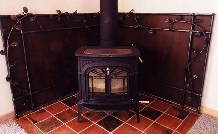If my wood stove sits in a corner would I be able to use two shields to  surround the stove in a triangular shape? - Drolet Heat Shield 42